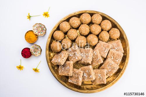 sesame laddu or tulgul or til gul laddu or ladu served in.