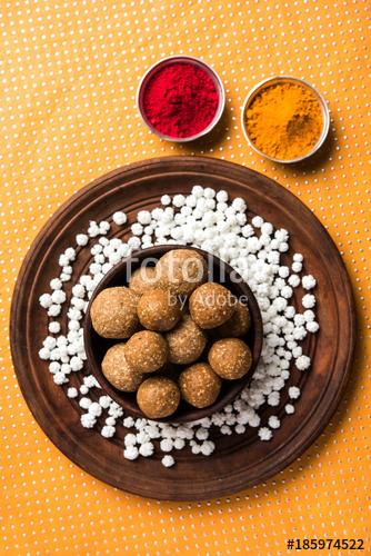 Tilgul or Til Gul with haldi Kumkum and halwa/chiranji or.