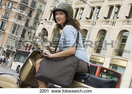 Stock Photography of Spain, Barcelona, woman in crash helmet.