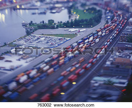 Stock Photo of Cargo trains in a shunting yard, tilt.