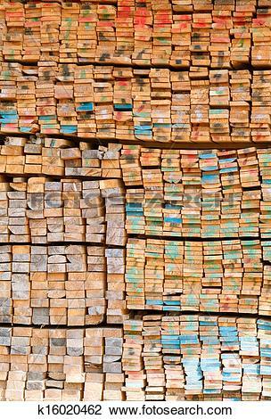 Stock Photo of stack of lumber in timber logs storage k16020462.
