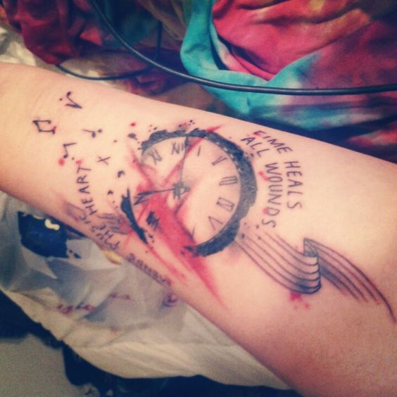 "my new tattoo. ""Time heals all wounds, while music mends the heart."