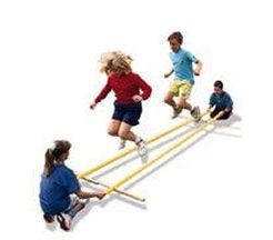 TiniklingBamboo jumping game! Don\'t remember the name.