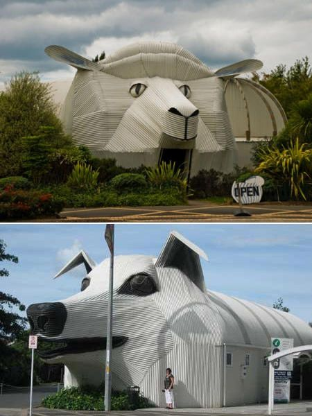 Sheep and sheepdog buildings made out of corrugated iron art.
