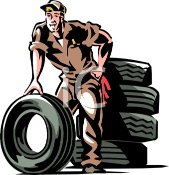 Mechanic Next To a Stack of Tires.