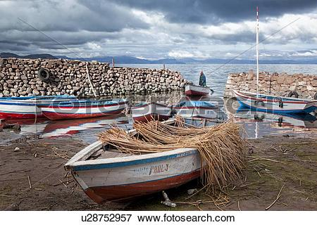 Picture of Lake Titicaca: Llachon peninsula, fishing boats moored.
