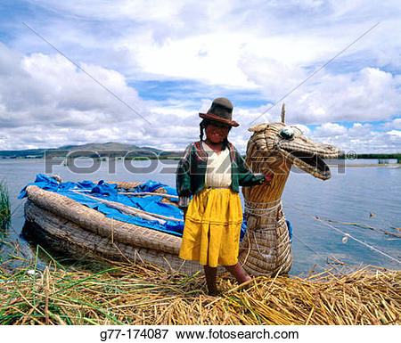 Picture of Uru indian woman and totora reeds boat. Titicaca Lake.