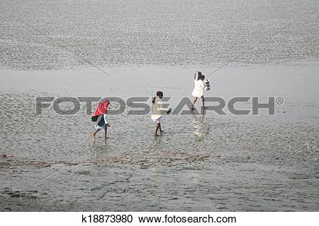 Stock Photography of During low tide the water in the river Malta.