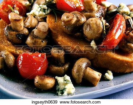 Stock Photograph of Mushroom Toast, mushrooms on toast, tomato.