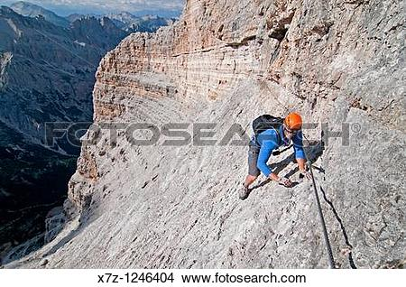 Stock Photo of Man climbing the Giovanni Lipella via ferrata on.