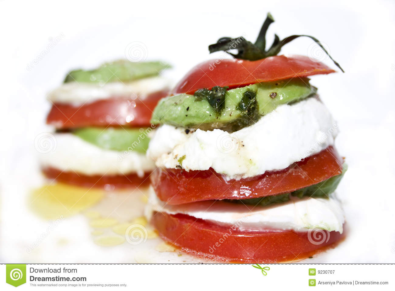 Tomato Mozzarella Salad With Avocado Royalty Free Stock.