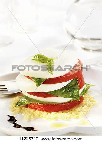 Stock Photography of A Stacked Tomato Mozzarella and Basil Caprese.