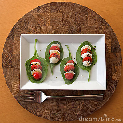 Tomato And Mozzarella Salad With Basil Decoration Stock Images.