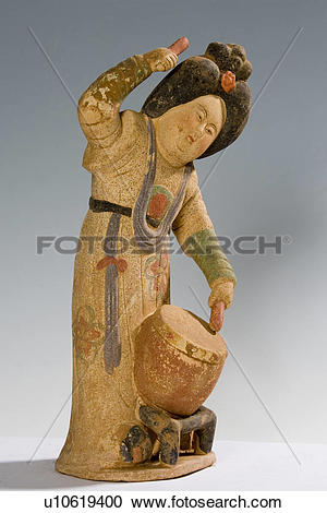 Stock Photography of Painted pottery tomb figure knocking drum.