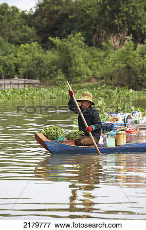 Picture of Woman in Canoe on Tonle Sap Lake Cambodia 2179777.