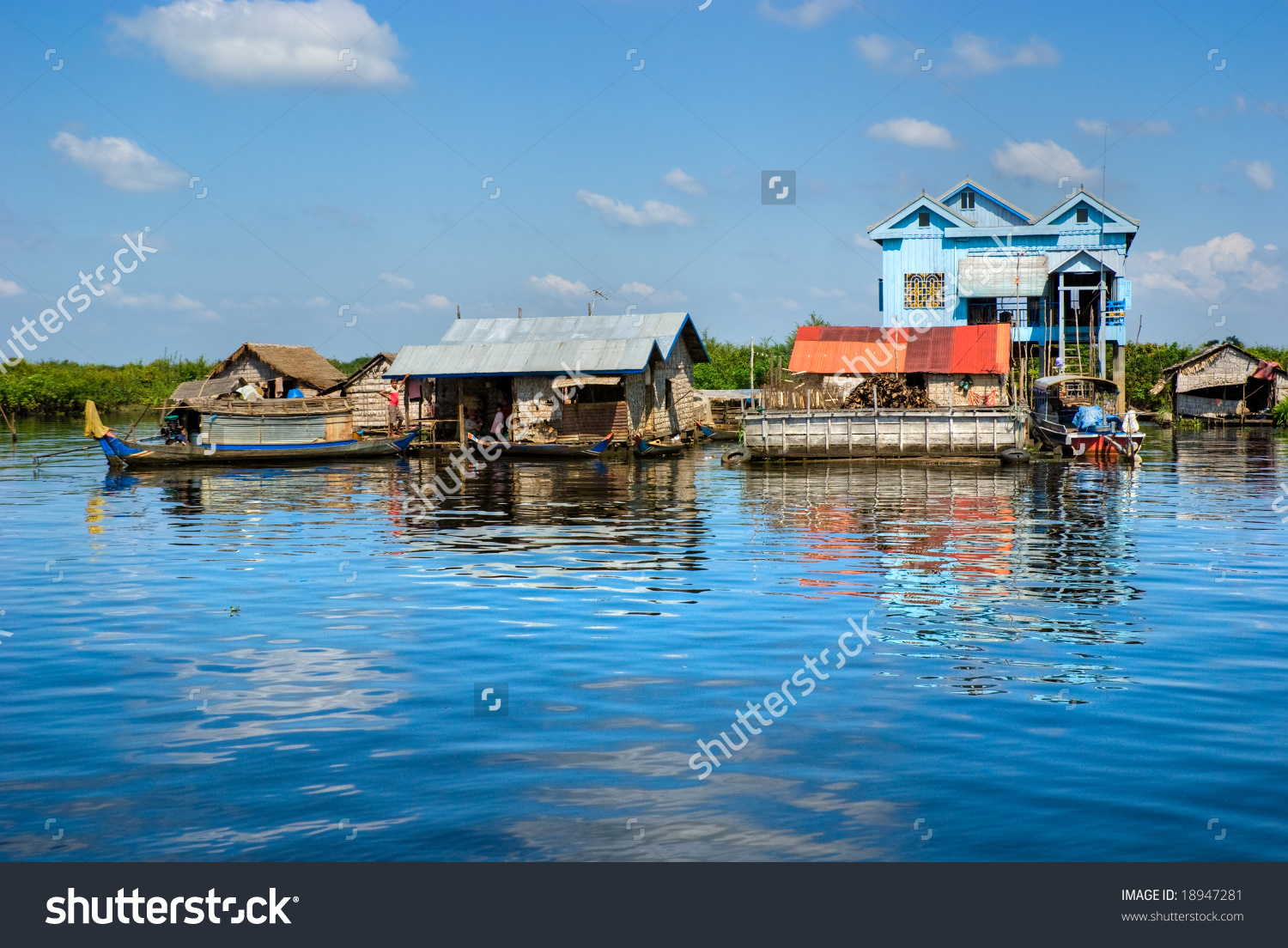Floating House And Houseboat On The Tonle Sap Lake, Between.