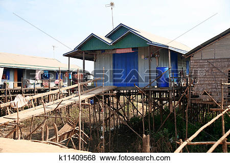 Pictures of Cambodian house of poor family at Tonle Sap Lake in.