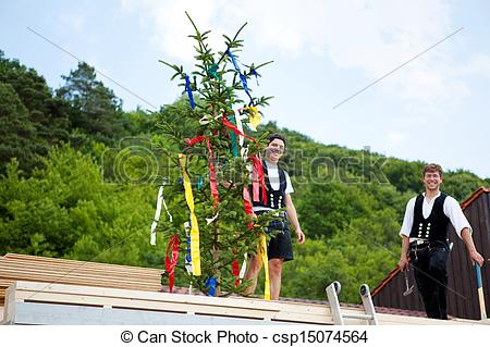 Stock Image of Carpenters performing the Topping Out ceremony.
