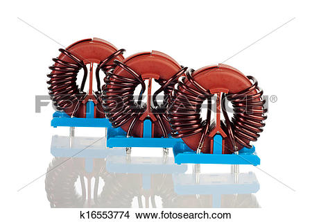 Stock Photo of Three Industrial Toroidal Choke Coils k16553774.