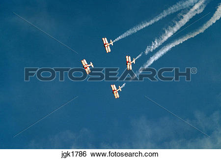 Stock Images of Four biplanes performing during airshow at.