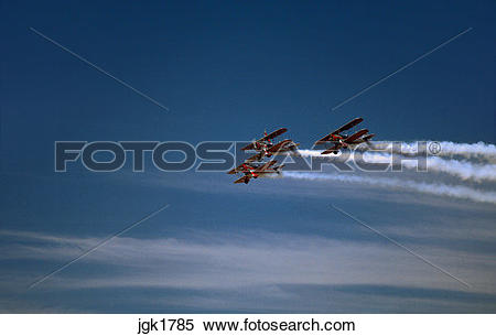 Stock Image of Three biplanes performing stunts during airshow at.