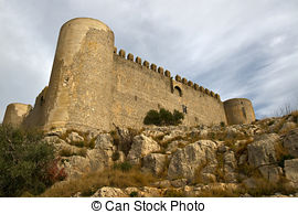Stock Photos of Medieval Castle of Torroella de Montgri on the top.