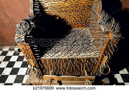 Stock Photograph of torture chair k21975609.