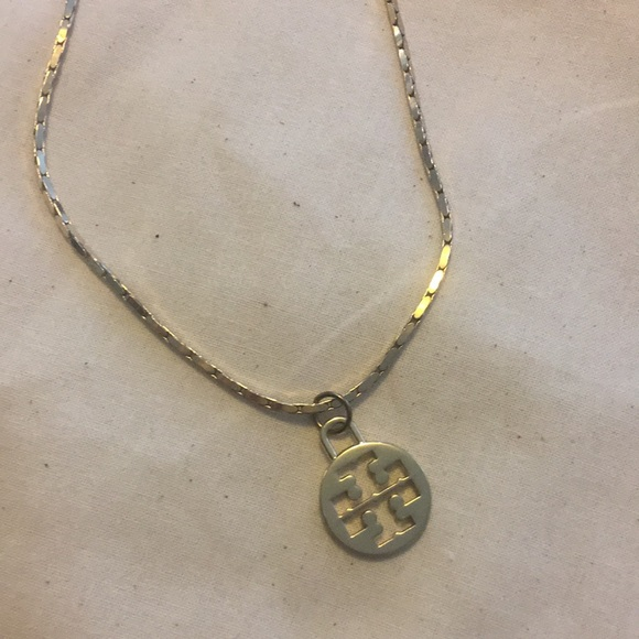 Tory Burch gold plated logo necklace.