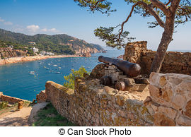 Stock Photography of Statue against old house in Tossa de Mar.