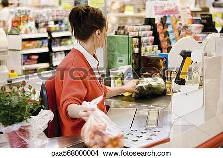 Stock Photo of Cashier totaling grocery purchases paa568000004.