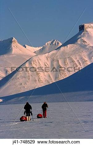Stock Photograph of Ski tourers hauling sledges on spring traverse.