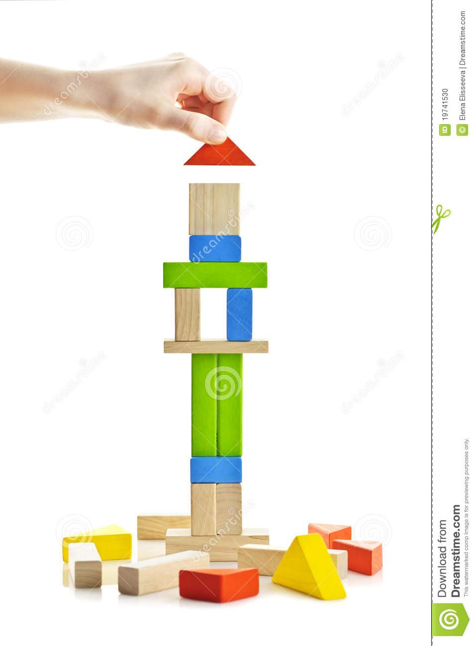 Wooden Block Tower Under Construction Stock Photo.