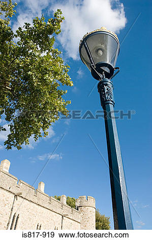 Stock Photograph of Lamppost and part of tower of london is817.