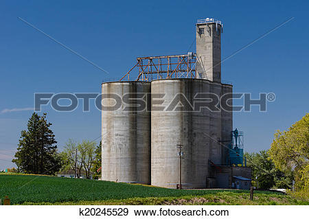 Stock Photograph of Concrete grain storage silos with elevator.