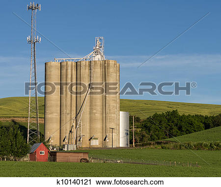 Stock Photography of Concrete grain silos with cell phone tower.