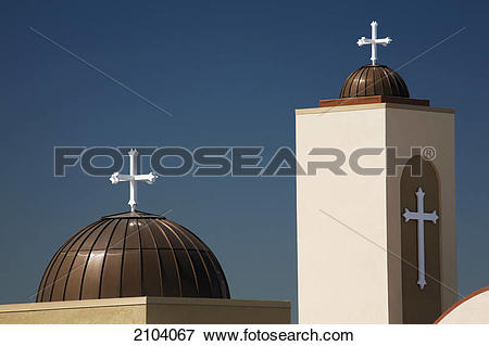 Picture of A coptic orthodox church tower and dome with blue sky.