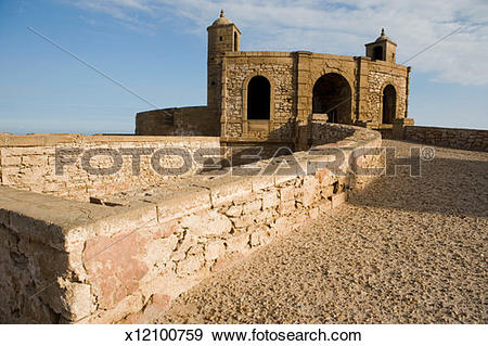 Stock Photograph of Morocco, Essaouira, path leading to tower on.