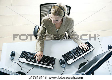 Pictures of Businesswoman with two computers, aerial view on a.