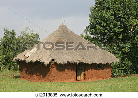 Stock Image of Traditional African Mud House with Grass Roof.