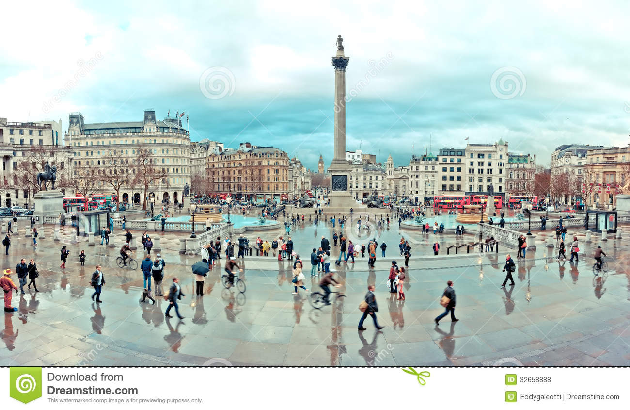 Tourists Visit Trafalgar Square In London Editorial Stock Photo.
