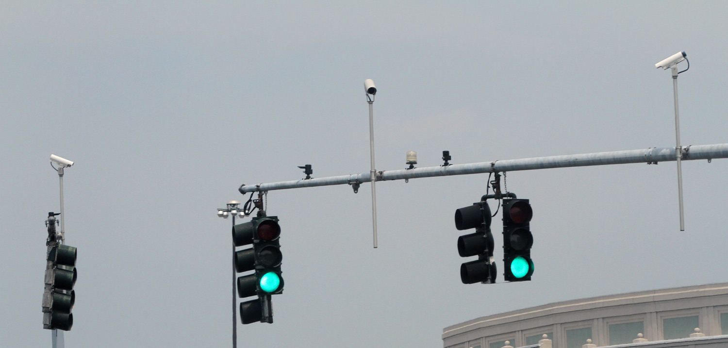 ACLU says profits from traffic cameras go to private companies.