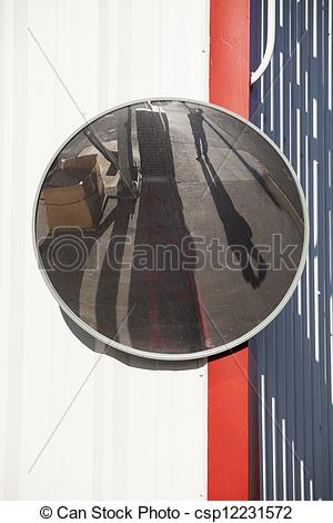 Picture of Traffic Mirror Mounted onWhite Metal Wall.