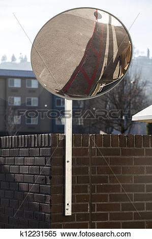 Stock Image of Traffic Mirror Mounted on Brick Wall k12231565.