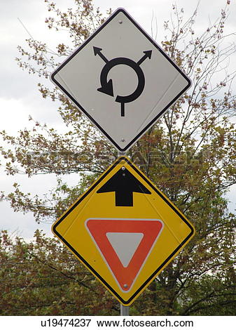 Picture of road sign, Yield Ahead sign, Approaching Traffic Circle.