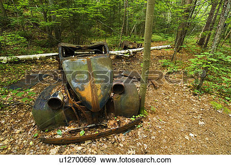 Stock Photograph of Abandoned car in woods along Granite Ridge.