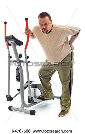 Stock Images of Man with back ache near a training device k4767586.