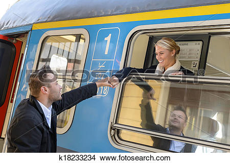 Stock Photo of Woman leaving with train man holding hand k18233234.