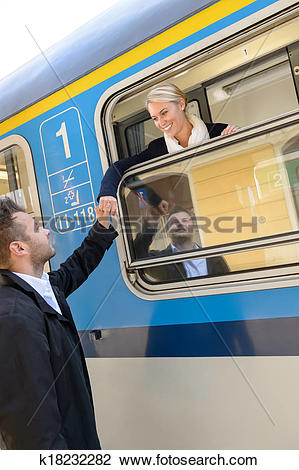 Stock Photo of Woman leaving with train man farewell couple.