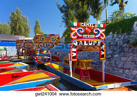 Stock Photo of Trajineras boats moored in a canal, Xochimilco.