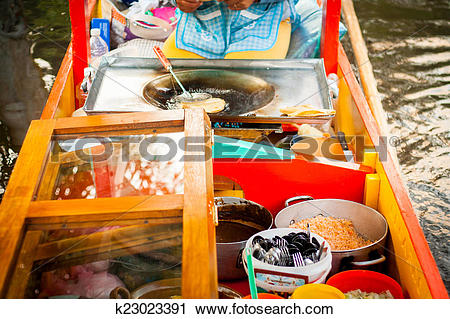 Stock Photography of Mexican vendor of food on Xochimilco gondola.